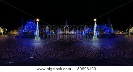 360 panorama of Avram Iancu Square at night lit up by Christmas decorations in Cluj-Napoca, Romania