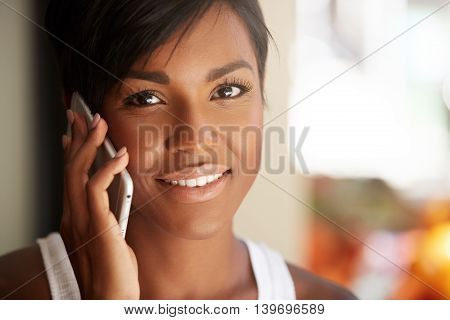 Cropped Portrait Of Cute African American Brunette Businesswoman With Short Hairstyle Looking At The
