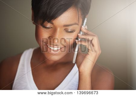 Headshot Of Attractive Young African Female With Healthy Clean Skin Talking On Mobile Phone, Invitin