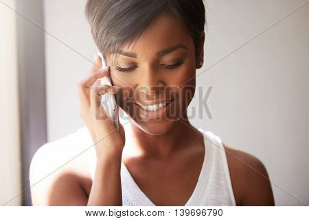 Portrait Of Young Good-looking African Woman With Cute Smile, Talking On The Phone With Her Little D