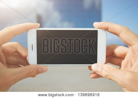 Close Up Shot Of Man's Hands Holding Generic Mobile Phone With Copy Space Touch Screen For Your Adve
