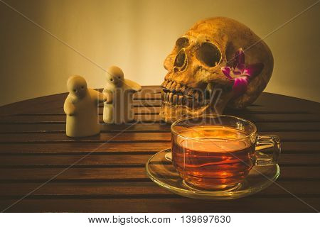 Still life with hot drink and human skull