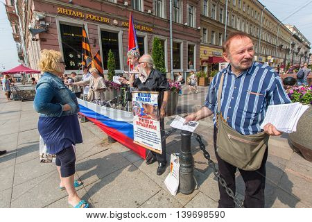 St.PETERSBURG, RUSSIA - JULY 24, 2016: Activists of the pro-Putin anti-western organization NLM SPb (National Liberation movement), on the Nevsky Prospekt.