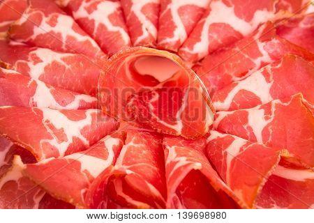 Sliced Italian  prosciutto close up. Prosciutto close up