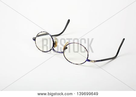 Retro man accessories - old vintage glasses on a white background