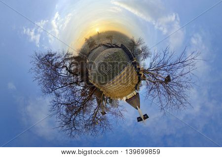 Stereographic (little planet) projection of the view from Acropolis Park (Parcul Cetățuia *** Fellegvár) at sunrise in Cluj-Napoca, Romania.