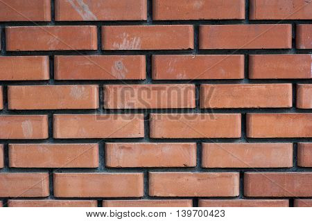 abstract background - large section of the wall of red brick