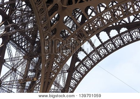 The metal structure of the Eiffel Tower amazing artistic design reminiscent openwork.