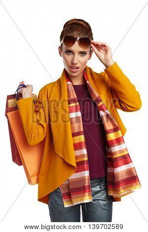 Autumn  woman with shopping bags over white background