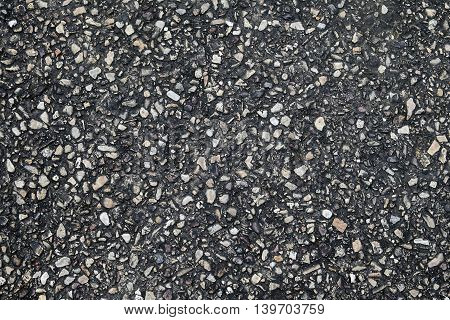 dark little rock concrete floor texture Asphalt road texture closeup surface Asphalt