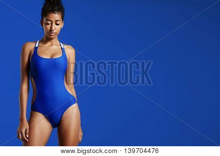 Bright Photo Of Woman In Blue Swimsuit On A Blue
