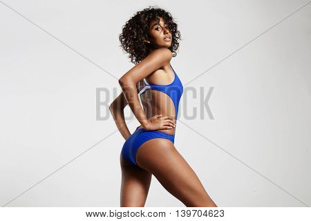 Beauty Woman Wears Swimsuit Posing And Watching At Camera