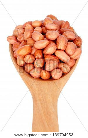 Nuts on wooden spoon isolated on white background.