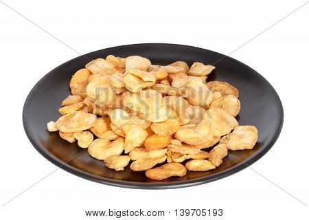 Nuts on plate isolated on white background.