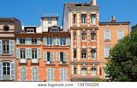Facades of buildings on Saint-Etienne square in Toulouse France