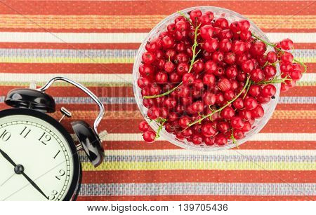 Healthy eating time concept with black alarm clock