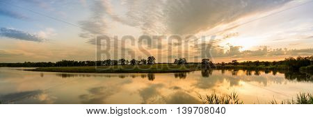 sunset on the lake, the beautiful sky in the reflection, panorama