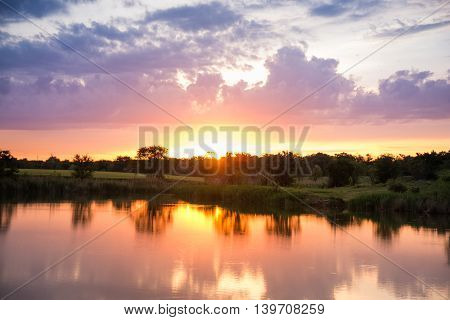 sunset on the lake, the beautiful sky in the reflection