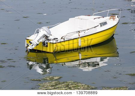 Small fishing boats waiting in port France water reflection