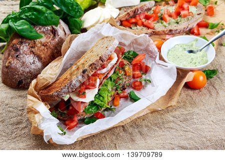 Fresh Sandwich with Bacon Lettuce Tomato and Mozzarella.