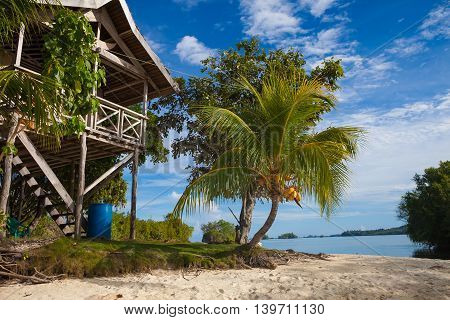 Photo Untouched Tropical Beach in Bali Island. Summer Season. Bungalow in Indonesia village. Horizontal Picture