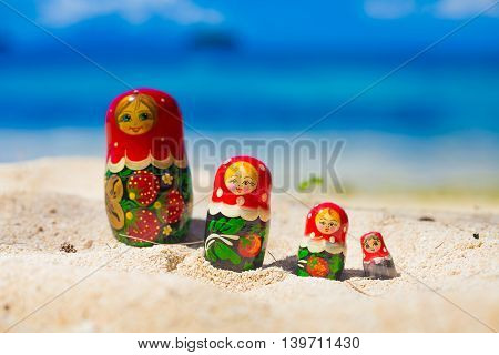 Photo Rows Puzzle Russian Dolls Matrioshka Souvenir Untouched Tropical Beach in Bali Island. Horizontal Picture. Blurred Background. Closeup