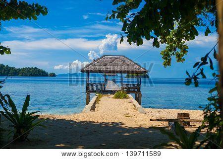 Photo Bungalow in Indonesia village Tropical Beach in Bali Island. Summer Season Caribbean ocean. Horizontal Picture