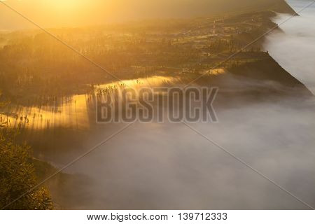 Sunrise Mountains.Asia Nature Morning Volcano Viewpoint.Mountain Trekking, View Landscape Valley Bali Village. Nobody photo. Horizontal picture. The first rays of the rising sun