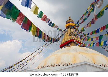 Picture of Boudhanath Stupa in the Kathmandu valley with clouds the sky Nepal. Horizontal photo