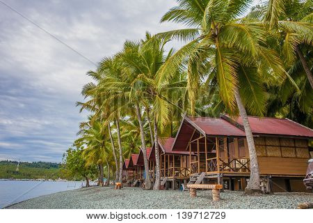 View Bungalow in Indonesia Village Tropical Beach in Bali Island Sunset.Romantic Viewpoint.Summer Season Caribbean ocean. Horizontal Picture