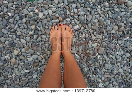 Closeup Photo Legs Young Girl Relaxing Beach.Highly Detailed Image Background.Horizontal picture