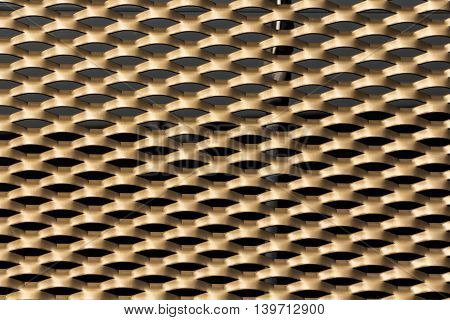 Close up shot of a gold coloured grille