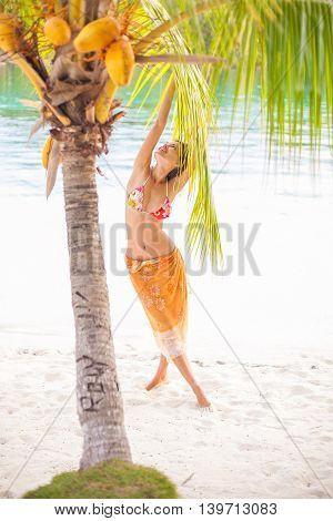 Portrait young beautiful girl relaxing on beach. Smiling woman spending chill time outdoor Bali island. Summer Season Caribbean Ocean. Vertical picture