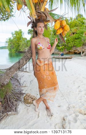 Smiling Woman Spending Chill Time Outdoor Bali Tropical Island. Exotics Summer Season Caribbean Ocean. Exotic Fruits Palm. Vertical Picture. Blurred background