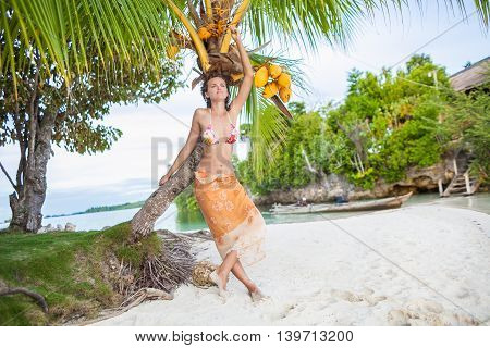 Smiling Woman Spending Chill Time Outdoor Bali Tropical Island. Exotics Summer Season Caribbean Ocean. Exotic Fruits Palm. Horizontal Picture. Long Tail Natural Wood Boat Blurred background