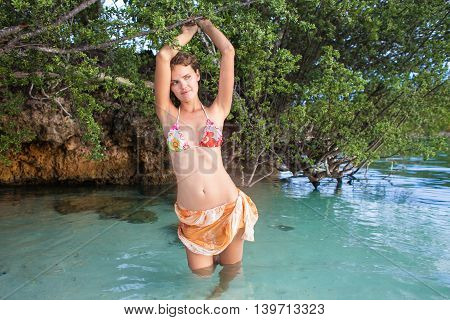 Photo Sexy Girl Posing Sea Beach Bikini. Smiling Woman Model Spending Chill Time Outdoor Summer. Caribbean Ocean Vacations. Horizontal, Blurred Background