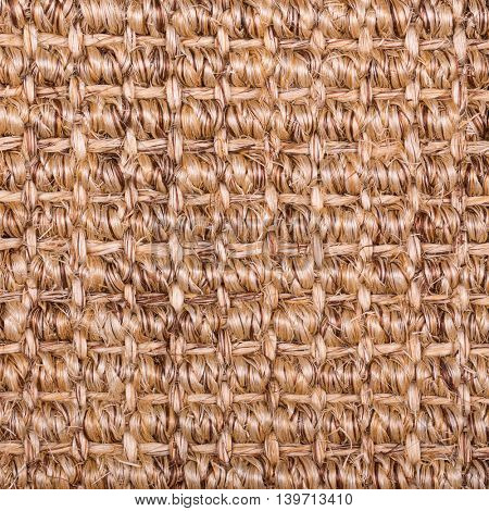 A background of sisal matting.