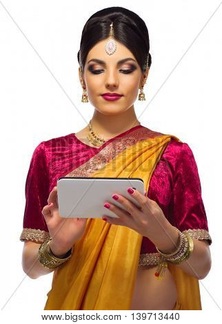 Indian woman with tablet PC isolated