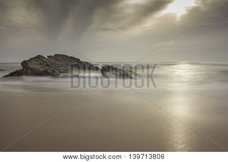 A Long Exposure of Rocks on Guincho Beach in Portugal
