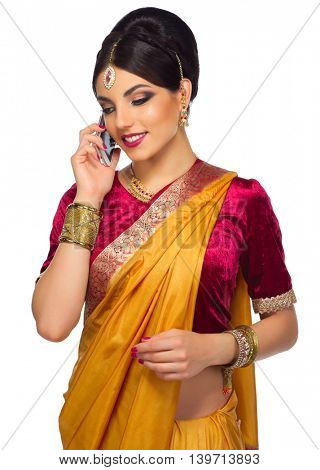 Indian woman with mobile phone isolated