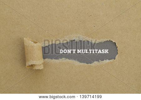 DO NOT MULTITASK message written under torn paper.