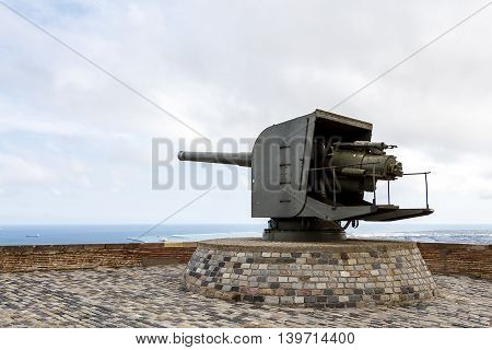 Large military gun looking out to sea