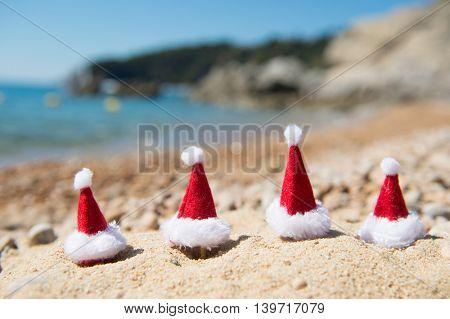 Row hats of Santa Claus at the summer beach