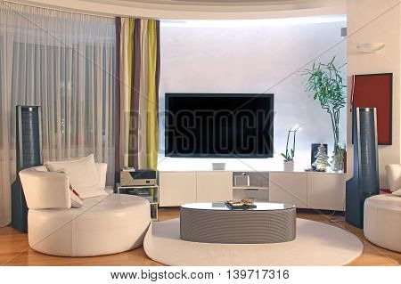 Modern living room interior with large TV