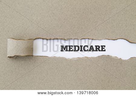 MEDICARE word written under torn paper concept.