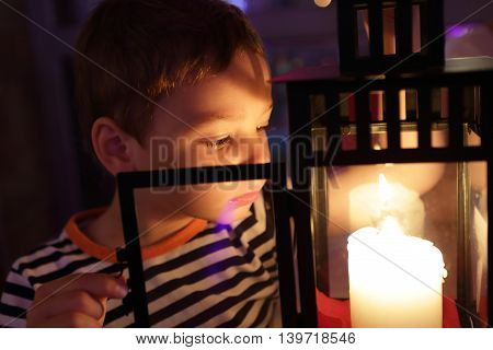 Boy Looking At Candle