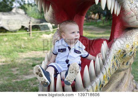 Toddler In Jaws Of Dinosaur
