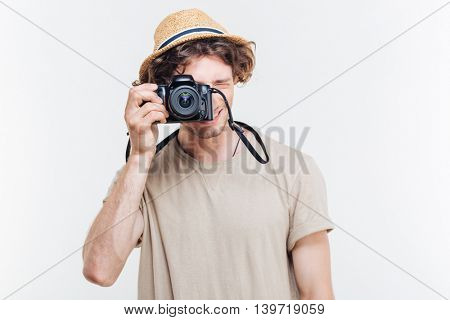 Portrait of a young man taking photo with camera