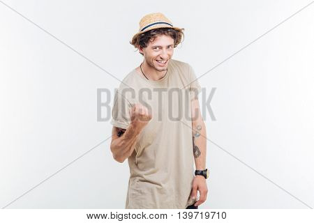 Handsome casual young man showing excitement isolated on white background