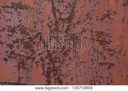 Abstract - rust and loose paint with metal.